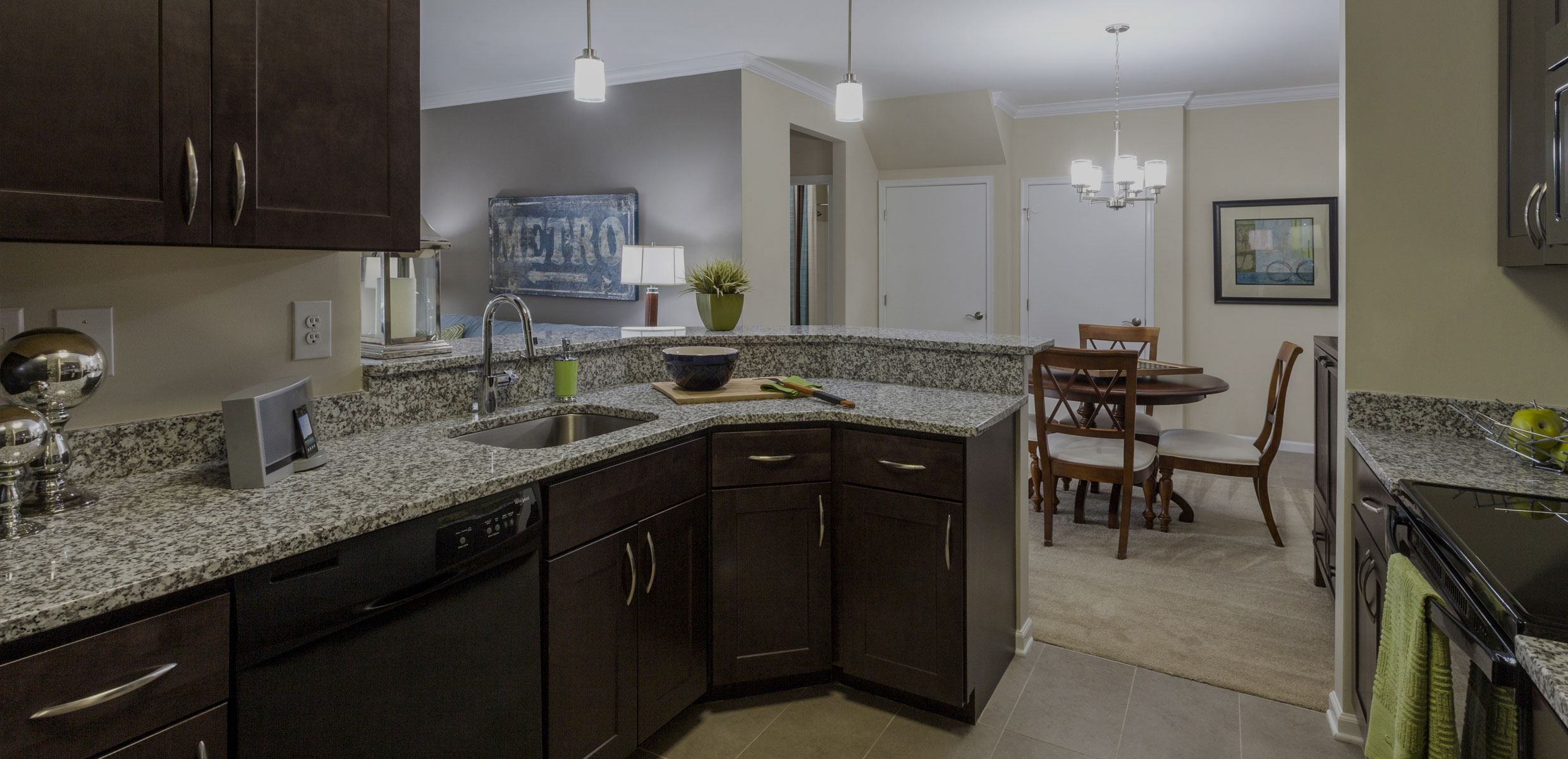 Chestnut Pointe Apartments Kitchen with espresso cabinetry and granite countertops
